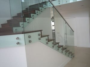 Advertisement Nail Glass Railing Wood Stair Balustrade Ouside Professional Design pictures & photos