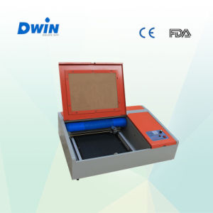 3020 Mini Portable CNC CO2 40W Laser Engraving Machine pictures & photos