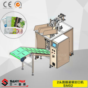 Dual Head Sealing Filling Auto Face Mask Packing Machine pictures & photos