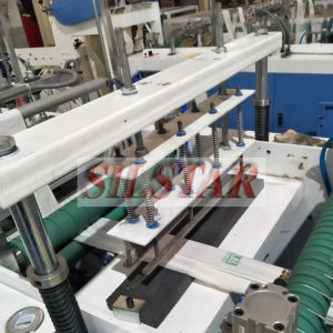 Full Automatic Double Lines Rolling Star Seal Bag Making Machine pictures & photos