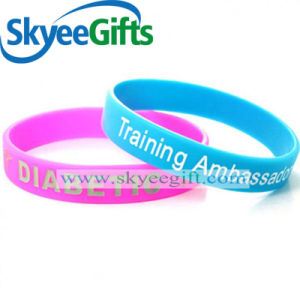 Promotion Gift Debossed Filled Color Silicone Wristband pictures & photos