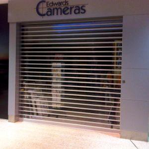 Coiling Security Automatic Grilles Transparent Plastic Strip Curtain Roller Door (Hz-TD019) pictures & photos