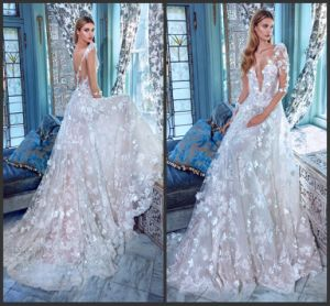 Flora Lace Bridal Gowns Sheer Long Sleeves Wedding Dress Gv20172 pictures & photos