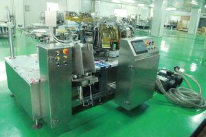 Rotary Vacuum Rotary Filling and Sealing Machine pictures & photos