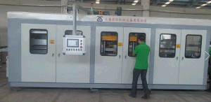 Zs-6171 Plastic Vacuum Forming Machine with PLC Control pictures & photos
