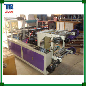 Continuous Rolling PE Plastic Carry Bag Making Machine pictures & photos