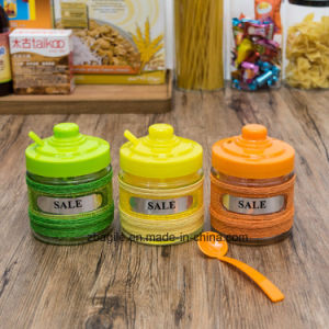 Factory Price Wholesale Colored Spice Storage Glass Jar with Plastic Lid and Spoon pictures & photos