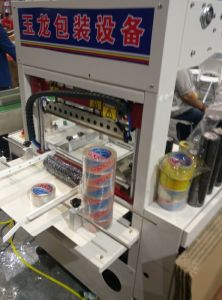 Manual Shrink Film Packing Machine pictures & photos