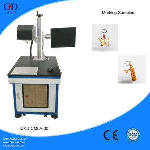 CO2 Laser Marking Machine Marking on Plastic Fabric Cloth pictures & photos