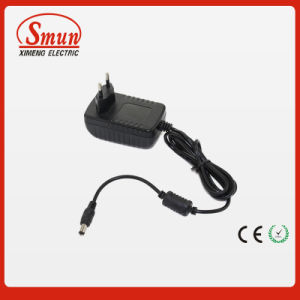 9VDC 1A EU UK Us Plug Universal AC/DC Adapter pictures & photos