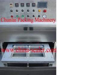 Vertical Vacuum Food Box Sealing Machine pictures & photos