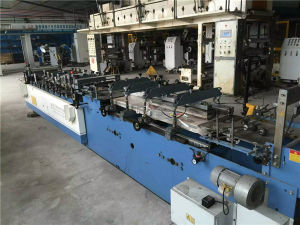 Second Hand Double Layer Three Side Sealing and Middle Sealing Bag Making Machine pictures & photos