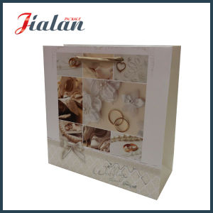 Newest Design Wholesales Glossy Lamination Custom Paper Wedding Gift Bag pictures & photos