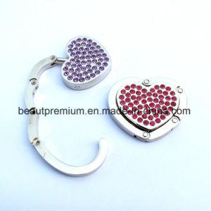 Fashion Heart Shape Crystal Bag Hanger L′oreal Audit Bag Holder BPS0133 pictures & photos