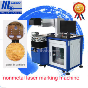 Cheap Plastic Wood Egg Crabs Sea Food CO2 Laser Marking Machine for Rubber Hose pictures & photos