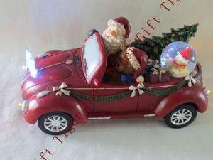 Polyresin Santa Driving Car W/Waterball Wled Light and Music