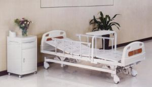 Luxurious Three Functions Manual Medical Bed with Rolling Dining Table (XH-B-10) pictures & photos