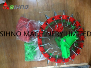 Hands Pushing Small Manual Grain and Beans Seeder Sell pictures & photos