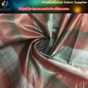 Polyester Yarn Dyed Check Fabric with Golden Silk & Calendering (YD1171) pictures & photos