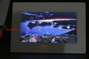 Alarm Clock with The Backlight on The Table pictures & photos