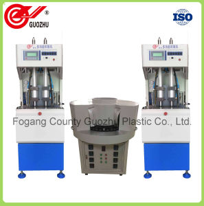 Semi Automatic 2 Cavity Pet Bottle Blow Moulding Machine pictures & photos