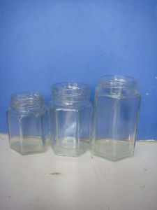 Small Hexagonal Glass Jars / Honey Container pictures & photos