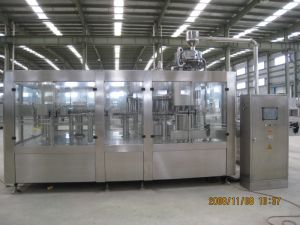 Washing, Filling, Capping 3 in 1 Machine in Glass Bottles pictures & photos