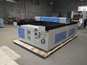 Jinan New Type CO2 Metal and Non-Metal Laser Cutting Machine pictures & photos