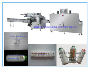 PLC Control Automatic Pesticide Bottle Shrink Packing Machine pictures & photos