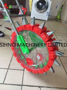 High Quality Hand Push Grain Seeder pictures & photos
