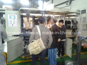 Pet Juice Bottle Blowing Mold Machine with Ce pictures & photos