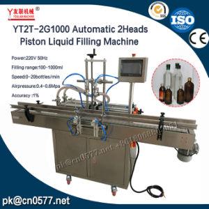 Yt2t-2g1000 Automatic 2heads Piston Liquid Filling Machine pictures & photos