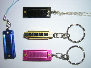 4 Holes Harmonica with Rope pictures & photos
