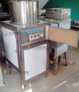 Cashew Nut Peeler Peeling Machine Cashew Shelling Machine for Nut Shop (YG-133) pictures & photos