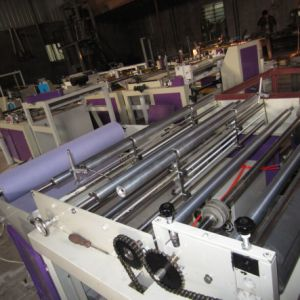 Non Woven Horizontal and Vertical Cutting Machine with Ultrasonic Welding pictures & photos
