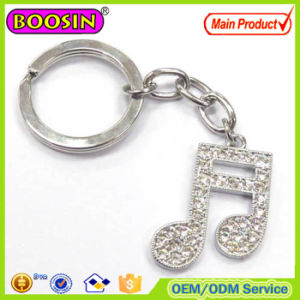 Professional Design! Custom Hand Made Rhinestone Golden Music Note Metal Keychain pictures & photos