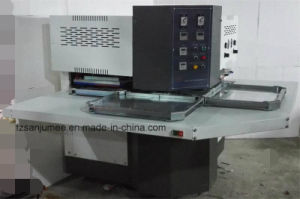 Heat Pressing Transfer to Cool Molding Machine (cutting and embossing machine) pictures & photos