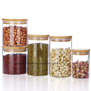 Round Shape Glass Food Storage Jar with Bamboo Lid pictures & photos