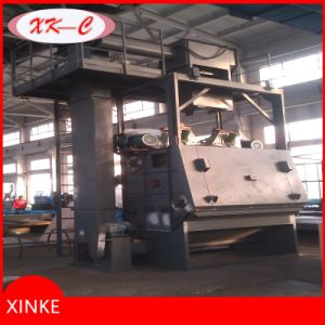 Rotating Barrel Wheel Automatic Feed Shot Blasting Machine pictures & photos