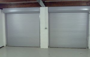 Aluminum and Steel Commercial Sectional Store Front Security Grilles Garage Door (fz-FC3650) pictures & photos