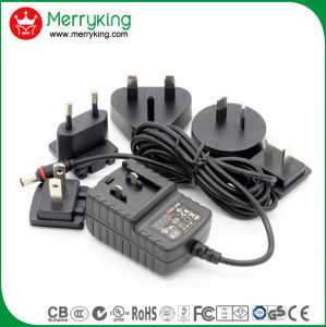 12V1a Interchangeable Adapter with Us EU Au UK Plug pictures & photos