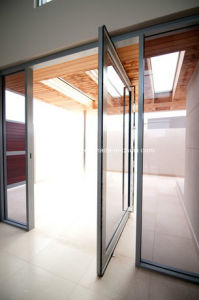 Anodized Aluminium Toughened Glass Pivot Door pictures & photos