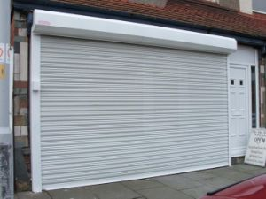 Electric Rolling Garage Door with Remote Control pictures & photos