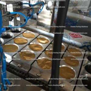Aluminium Foil Cup Filling Sealing Machine pictures & photos