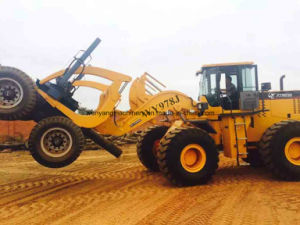 Rough Terrain Wheel Loader with Grapple Working in Africa Forestry pictures & photos