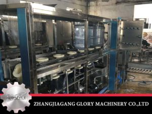 100bph 5gallon Mineral Water Filling Machine in Plastic Bottle pictures & photos
