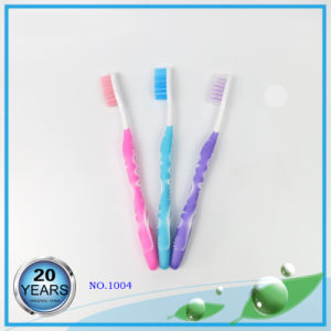 Soft Rubber Injection with PP Handle Nylon Toothbrush pictures & photos