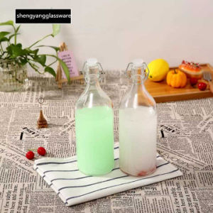 Glass Bottle Milk Bottle with Seal Lid Glassware Beverage Container Juice Storage Jar pictures & photos