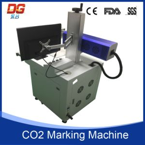 Hot Selling Mini Fiber Laser Marking Machine for Plastic Bottle pictures & photos