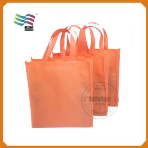 PP Non Woven Christmas Drawstring Gift Bags pictures & photos
